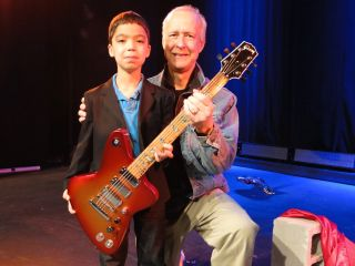 Henry Juszkiewicz and a young guitar hero in training at the Firebird X launch in NYC October 2010
