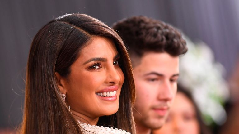 Indian actress Priyanka Chopra (L) and US singer-songwriter Nick Jonas arrive for the 62nd Annual Grammy Awards on January 26, 2020, in Los Angeles. (Photo by VALERIE MACON / AFP) (Photo by VALERIE MACON/AFP via Getty Images)