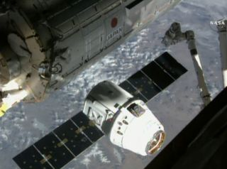 An unmanned SpaceX Dragon cargo ship delivers fresh NASA supplies to the International Space Station on April 17, 2015 in this still from a exterior station camera. It was SpaceX's sixth commercial cargo delivery for NASA.
