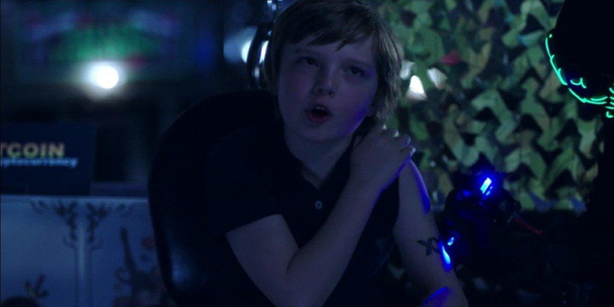 Rhys Slack as Dylan on Upload