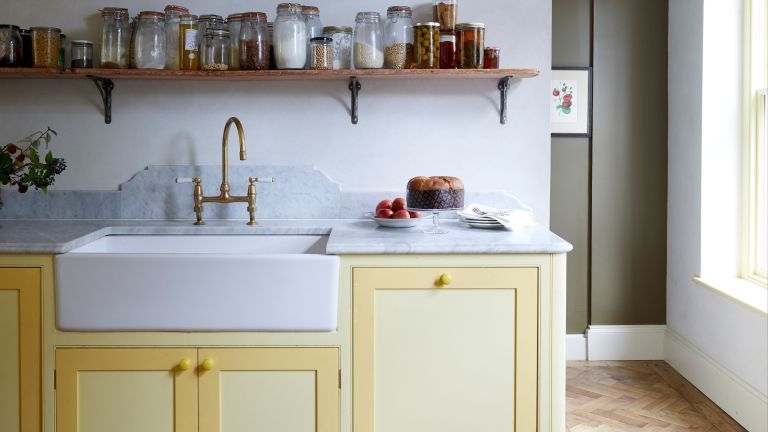 Utility room ideas with yellow painted cabinetry