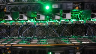 Cryptocurrency mining rigs sit on racks at a facility in Quebec, Canada