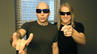 Joe Satriani and Steve Morse photographed backstage at the Tower Theater Upper Darby PA Sept 28 2013