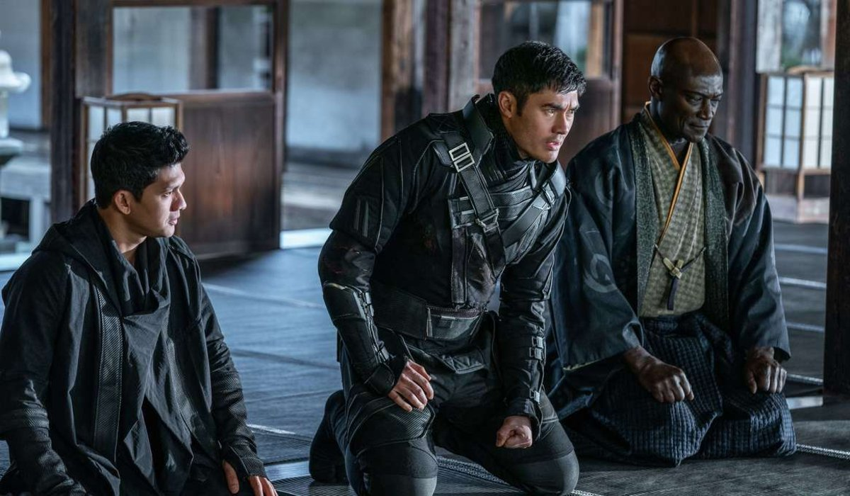 Andrew Koji, Henry Golding, and Peter Mensah kneeling with respect in Snake Eyes.