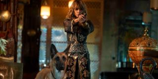 Halle Berry aims her gun with a trusted dog by her side in John Wick: Chapter 3 - Parabellum.