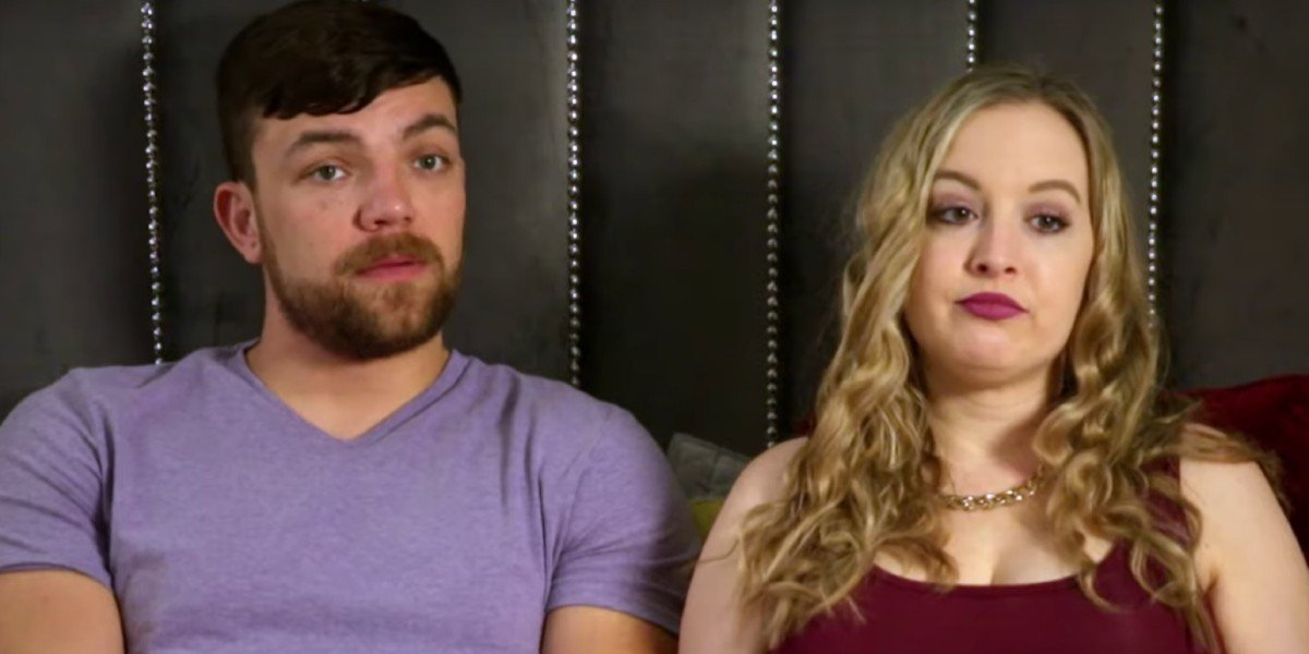 Libby and Andrei looking upset on their bed 90 Day Fiance