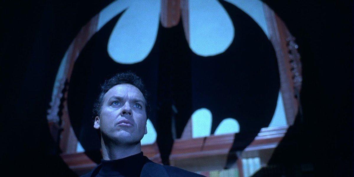 Bruce Wayne (Michael Keaton) answers the Bat-signal in Batman Returns (1992)