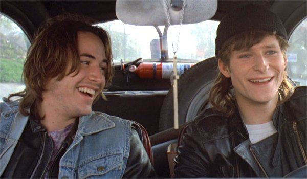 Rivers Edge Keanu Reeves smiling at Crispin Glover
