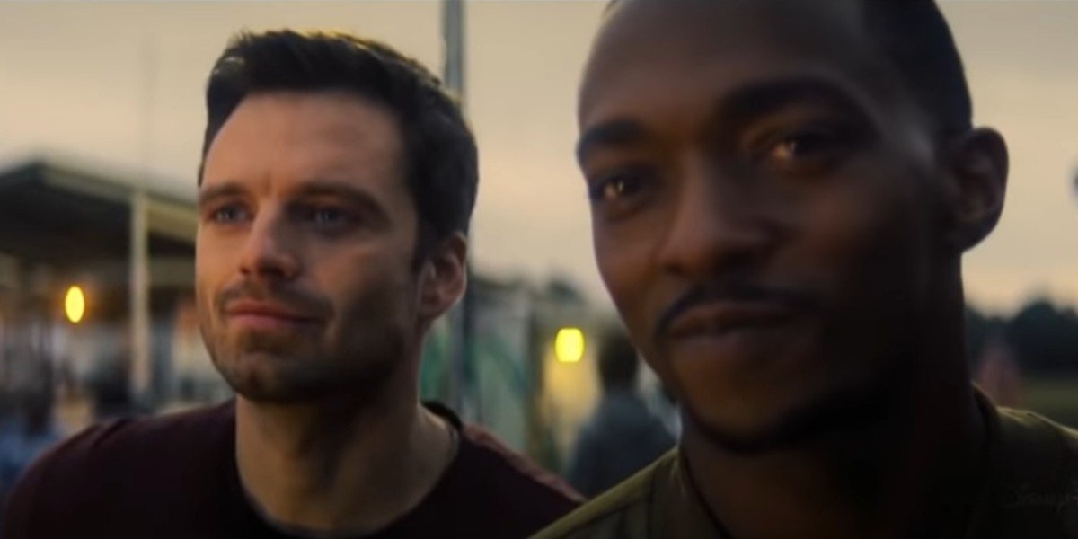 Anthony Mackie and Sebastian Stan as Sam Wilson and Bucky Barnes looking on in The Falcon and the Winter Soldier