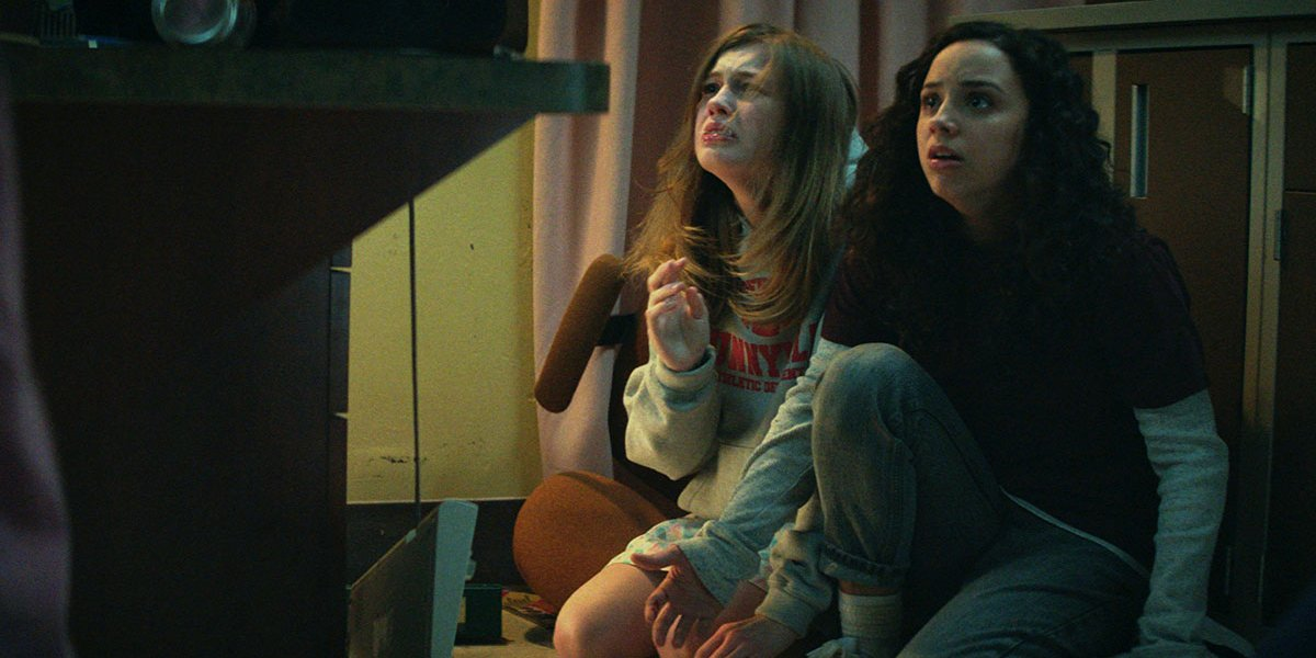 Olivia Welch and Kiana Madeira look up in horror in Fear Street: Part 1 - 1994.