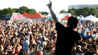 a picture of rise against and crowd at warped tour