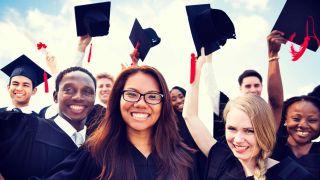 Graduates wave their caps