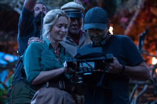 Jungle Cruise: stars Emily Blunt and Dwayne Johnson review the monitors on set with director Jaume Collet-Serra