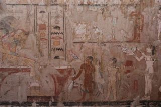 The tomb contains well preserved wall paintings, including this image showing fish and other goods being presented to Hetpet, who is shown seated at the far left.