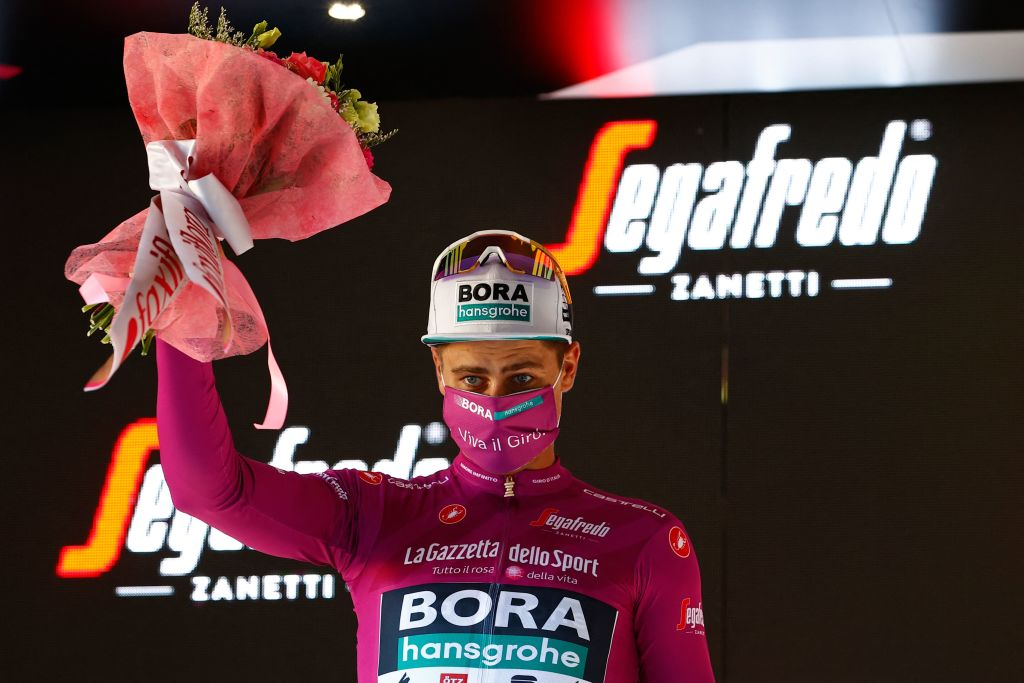 Team BoraHansgrohe rider Slovakias Peter Sagan celebrates his best sprinters Cyclamen jersey on the podium after the twelfth stage of the Giro dItalia 2021 cycling race 212 km between Siena and Bagno di Romagna on May 20 2021 Photo by Luca Bettini AFP Photo by LUCA BETTINIAFP via Getty Images