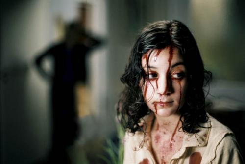 Let the Right One In - Lina Leandersson as the mysterious Eli