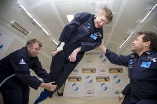 Professor Stephen Hawking experiences the freedom of weightlessness during a zero gravity flight.
