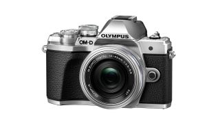 A black and silver Olympus OM-D E-M10 Mark III camera
