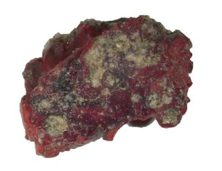 This sample of red trinitite, forged from the world's first nuclear bomb test, contains a crystal never seen before on Earth.