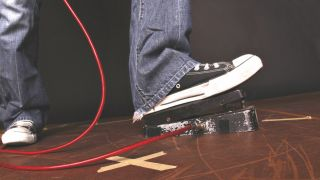 Foot resting on a wah pedal