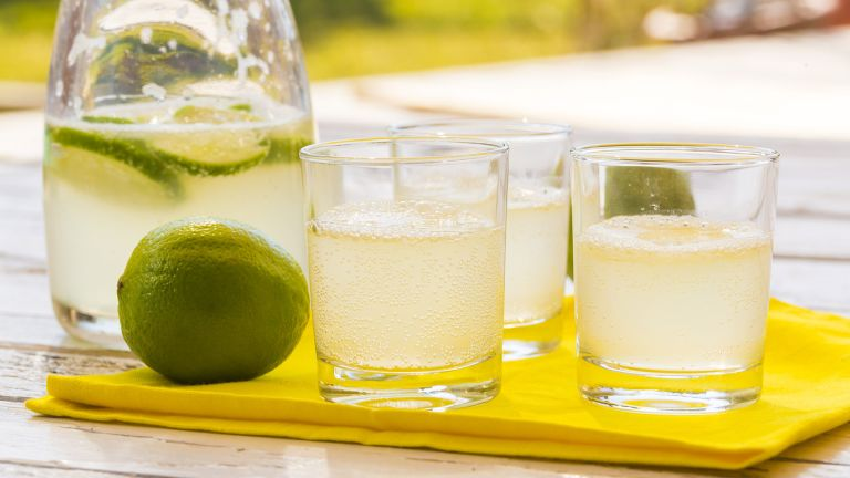 Carafe with glasses on a tray filled with lemonade