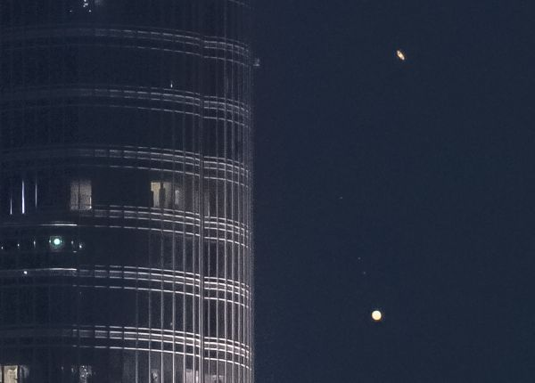 Jupiter and Saturn descend on world's tallest building in epic 'Great Conjunction' video