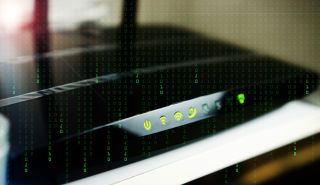 'Matrix'-like green numbers flowing vertically over image of home Wi-Fi router.