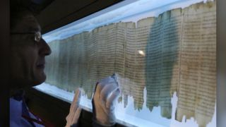 The Great Isaiah Scroll, one of the seven original Dead Sea Scrolls found in the late 1940s, on display at theAsia Society Hong Kong Center. In a new study, researchers determined that two scribes wrote this scroll.