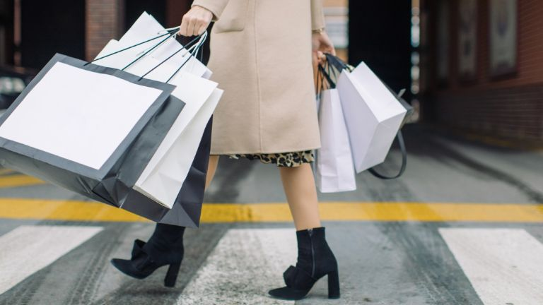 woman with bags black friday fashion deals