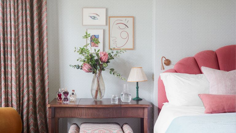Pink and blue bedroom with subtle pattern wallpaper