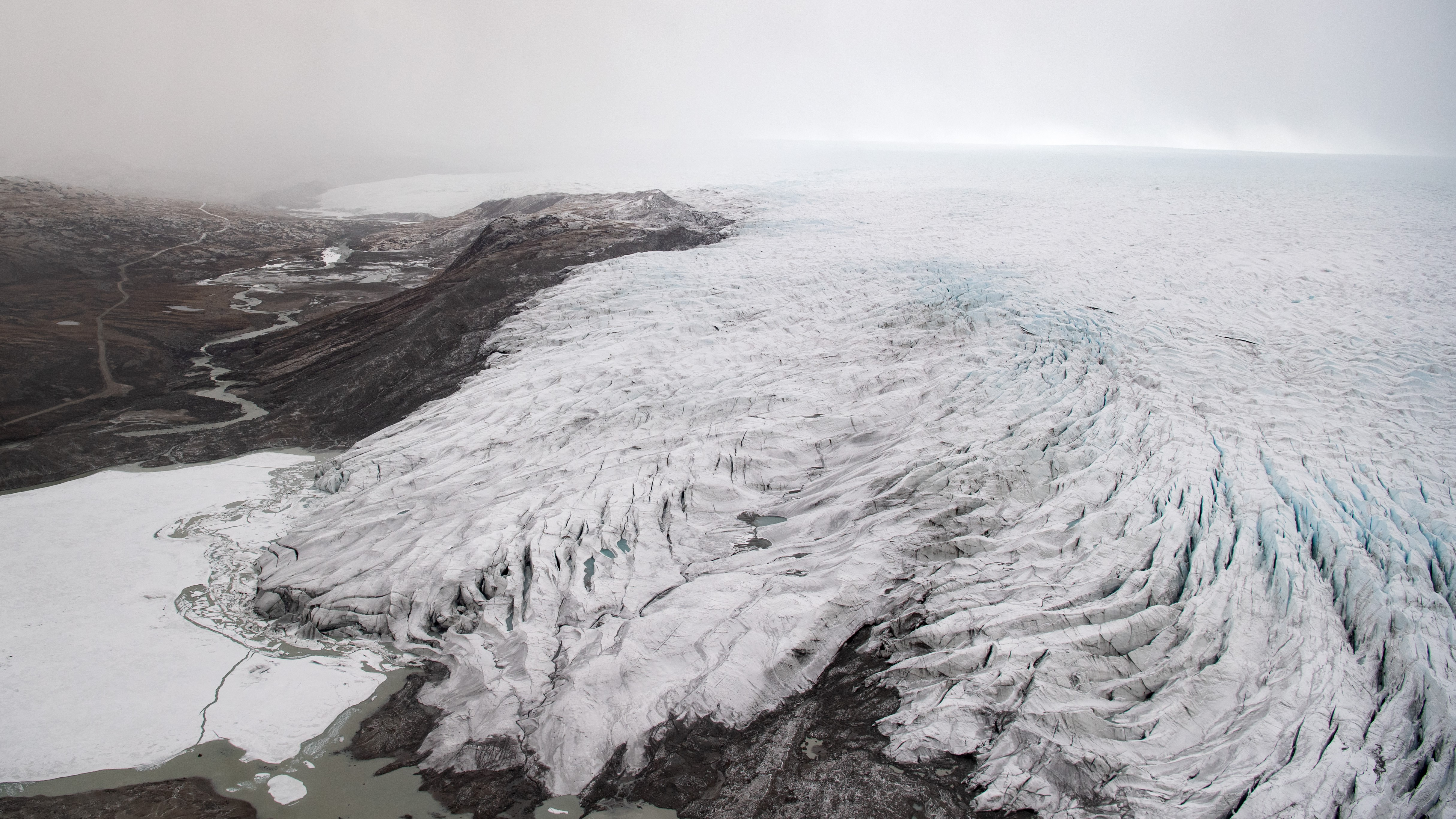 Ice receding from a glacier near Kangerlussuaq, Greenland. This photo was taken during a helicopter tour of the region with US Secretary of State Antony Blinken in May 2021.