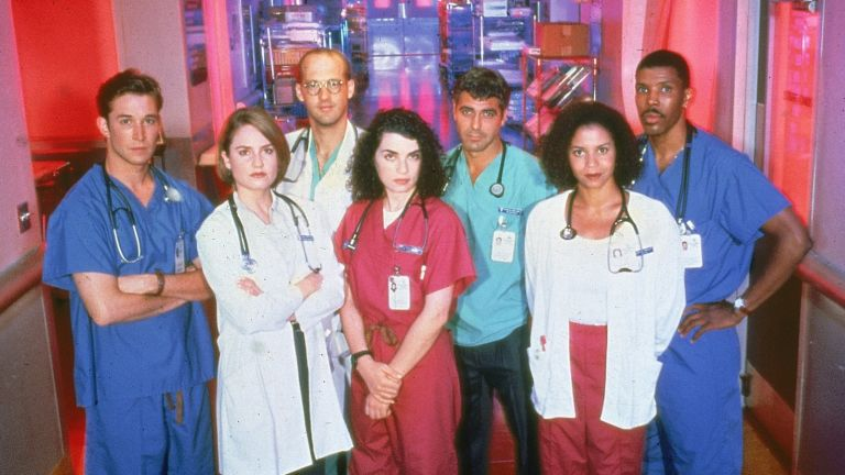 """Promotional portrait of cast members from the television series, """"E.R.,"""" c. 1996. L-R: Noah Wyle, Sherry Stringfield, Anthony Edwards, Julianna Margulies, George Clooney, Gloria Reuben and Eriq La Salle."""