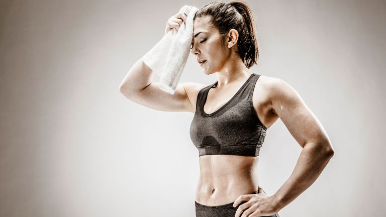 Woman doing 30-day fat-burn workout challenge