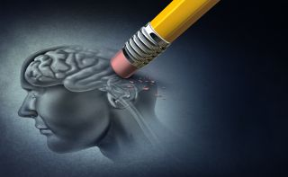 An illustration of a pencil erasing parts of a brain to conceptualize Alzheimer's disease