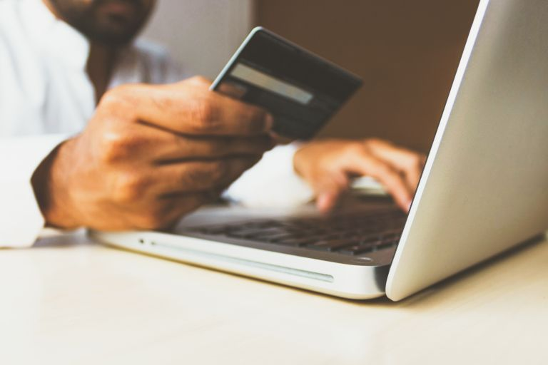 Free stock image of a man shopping online with credit card- Unsplash