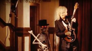 Brian May serenades a skeleton