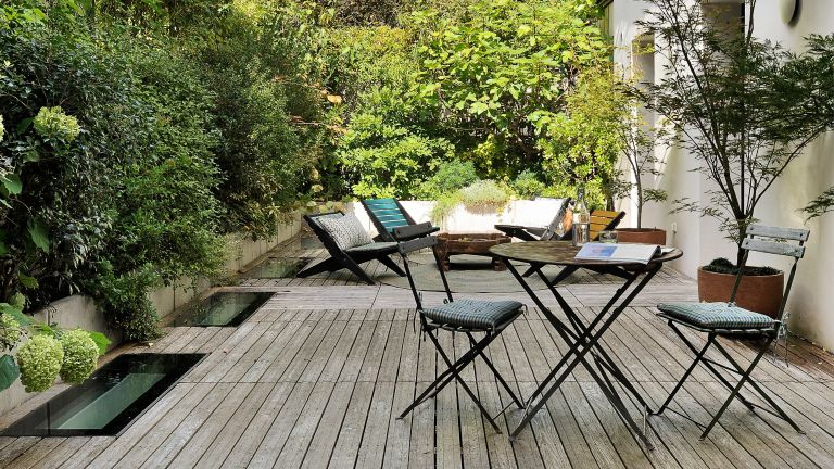 Modern outdoor furniture idea with bistro table and seating around fire pit