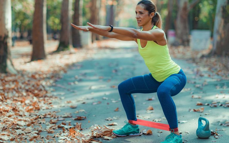 Woman doing a lower body resistance band workout