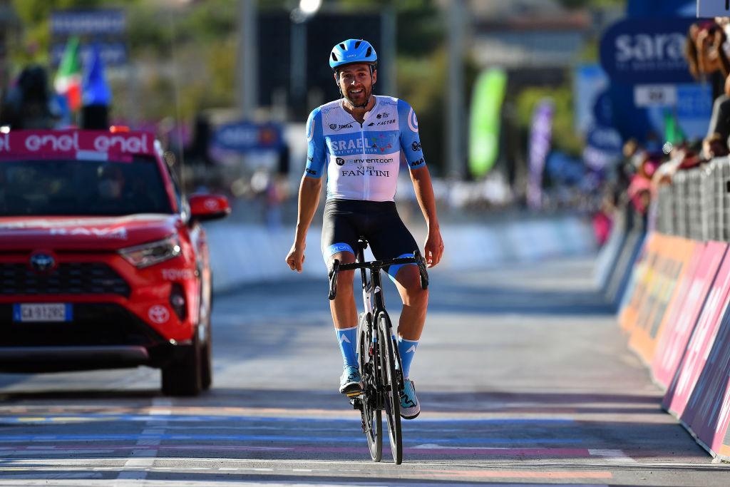 VIESTE ITALY OCTOBER 10 Arrival Alex Dowsett of The United Kingdom and Team Israel StartUp Nation Celebration during the 103rd Giro dItalia 2020 Stage Eight a 200km stage from Giovinazzo to ViesteGargano girodiitalia Giro on October 10 2020 in Vieste Italy Photo by Stuart FranklinGetty Images