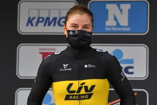 WEVELGEM BELGIUM MARCH 28 Podium Lotte Kopecky of Belgium and Team Liv Racing Celebration during the 10th GentWevelgem In Flanders Fields 2021 Womens Elite a 1417km race from Ypres to Wevelgem Mask Covid Safety Measures GWE21 GWEWomen FlandersClassic UCIWWT on March 28 2021 in Wevelgem Belgium Photo by Luc ClaessenGetty Images