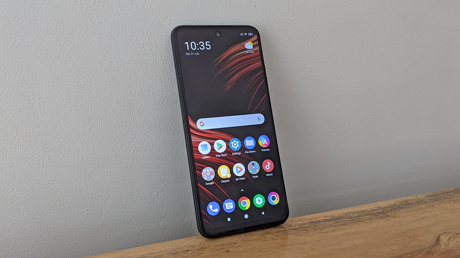 The Poco M3 Pro 5G from the front, on a table