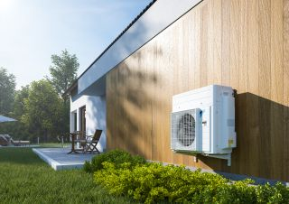 air source heat pump on outside of a home