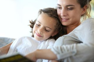 A mom reads to her daughter