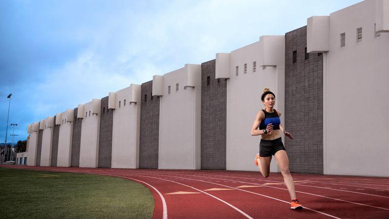 best running watch: women running on track
