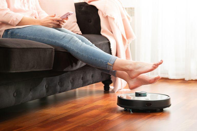 Walmart vacuum Robot vacuum next to couch