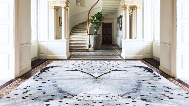 Alexander McQueen rug with a large butterfly design