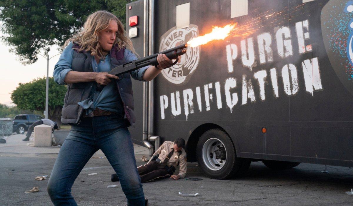 Leven Rambin firing a shotgun in The Forever Purge.