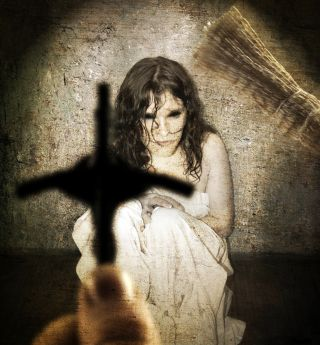 A scared girl with a cross as if getting an exorcism,