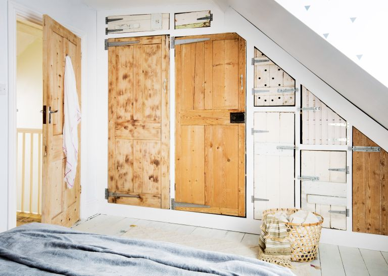 Loft storage idea: Wardrobe in a loft bedroom made from reclaimed doors