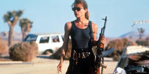 Terminator 2: Judgement Day Sarah Connor holding an automatic rifle in the desert